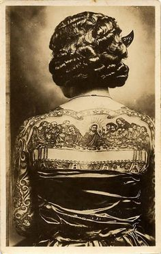 Artoria Gibbons with her Last Supper tattoo on her back