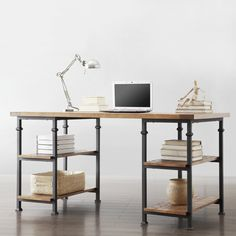 This Myra desk has a weathered, timeworn patina, allowing traces of natural wood and original colors to show through. The frame of this home office furniture is made of black sand metal with two shelves to provide storage.