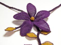 Turkish lace oya choker  -  Silk embroidered / crocheted flower  -  Golden yellow and purple  -  Boho style fiber art fashion by Land of Dante, via Flickr