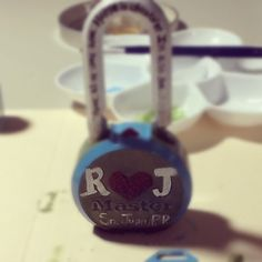 Rebecca Maria designing her Love Lock to be placed on the Pont Des Arts in Paris