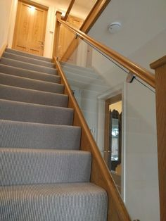 Glass balustrade to an oak staircase in Harpenden