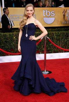 Amanda Seyfried - that shapely front panel and the train flowing is s flattering.  Her hair style just repeats the pattern of the dress.  I like the necklace although I'm thinking a simple one that didn't drop over the dress would have been nice too.