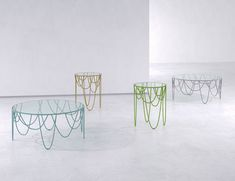 Drapery table collection - Love the undulating skirt-like base of the Drapery collection from Nathan Yong for SpHaus.