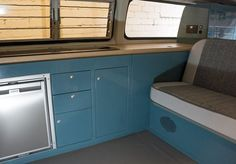 Dubteriors T2 Bay window interior in VW Neptune Blue with oak worktops