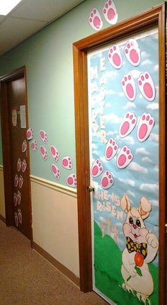 My Easter Classroom Door Picture 2...my classroom has 2 doors but only 1 is utilized so I decided to put bunny tracks across both doors.