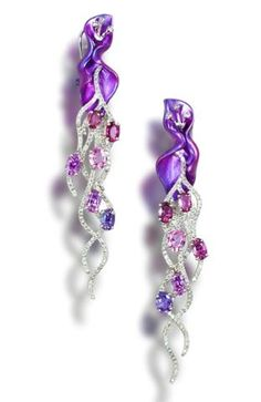 A pair of titanium, coloured sapphire and diamond earrings...only $5k....HA
