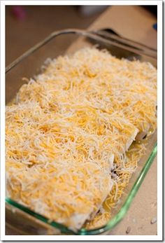 TO-DIE-FOR CREAM CHEESE CHICKEN ENCHILADAS 2-3 chicken breasts, shredded 1 {8 oz.} pkg. cream cheese 1 28 oz. can green enchilada sauce 1 can black beans, drained & rinsed 2 cups cooked rice Tortillas 1-2 cups shredded monterrey & colby cheese Cook chicken and shred; boil rice. Mix the shredded chicken, cream cheese, and 2 cups of the enchilada sauce together.