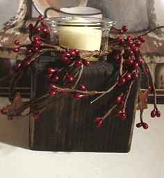 Primitive Country wood candle holder with pip berrys with stars and handmade scented candle. $7.99, via Etsy.