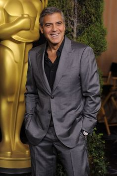 George Clooney in grey suit and black shirt. Nominated for Best Actor for The Descendants--2012?