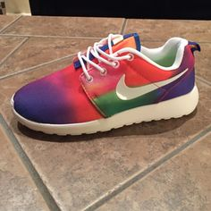 Women's Custom Nike Roshe Run Shoes NEW!!! Brand new with tags, Women's CUSTOM Nike Roshe Run shoes. They are size 8. These rainbow colors are a very unique custom color and very rare. They are super comfortable and well as very light in weight. If interested comment me or send me an offer, no trades please. Nike Shoes Athletic Shoes