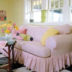 An overstuffed sofa was a daring addition to a small living room, but its grand size visually anchors the space and provides an extra sleeping spot. Reminiscent of ticking fabric, the casual pink-and-white-striped slipcovers can be tossed into the washing machine, making them an easy-care option for a vacation home.