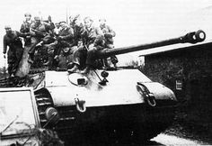 A German King Tiger tank, loaded with troops...