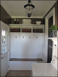 organized mud room with shoe storage bench
