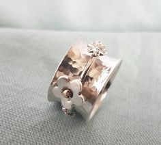 Spinner ring//solid silver ring with silver and gold flowers//fidget ring//hallmark