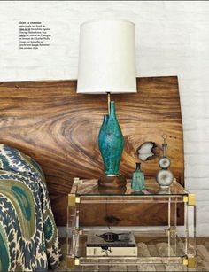 A whorled slab of woodgrain creates a statement headboard in this Palm Springs bedroom, featured in Architectural Digest France