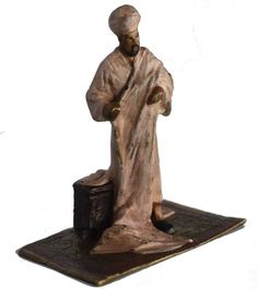 """Piece is signed 3 times, Bruno Zach signature, Argentor & Bergmann stamps. Cold painted bronze depicting a man from the Far East standing on an oriental carpet. Dimensions H= 3.5"""" H= 9cm"""