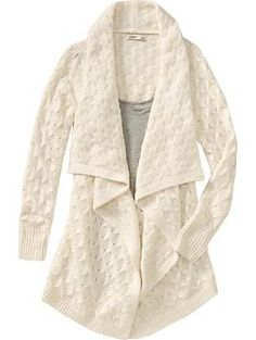 tried this on today. didn't buy it. but i want it. so badly. such a warm and comfy cable wrap sweater.