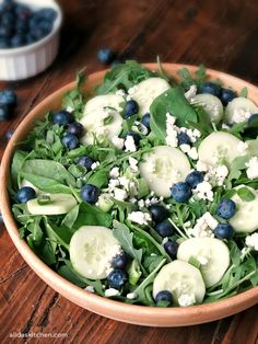 Balsamic Blueberry Salad combines peppery arugula, tangy feta cheese, sweet blueberries and other fresh vegetables, tossed with a light balsamic vinaigrette. Pe