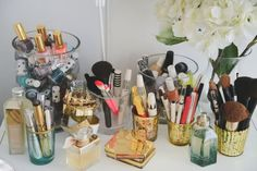 simple glass vases and votive holders for organizing your makeup | Dria Murphy's New York City Home Tour. theeverygirl