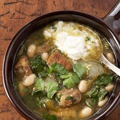 Slow Cooker Chili Verde  ..      This traditional Mexican chili features pork, tomatillos, white beans, chile peppers, and a topping of sour cream and fresh cilantro.