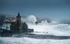 Here comes Frank: Britain's sixth named storm is already causing carnage across the country, particularly in the west of England, where gale-force winds have uprooted trees and sent large waves crashing over coastal defences, including in Porthleven, Cornwall (pictured)