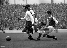 Circa 1967. Spurs inside forward Jimmy Greaves skips past Arsenal's Frank McLintock.