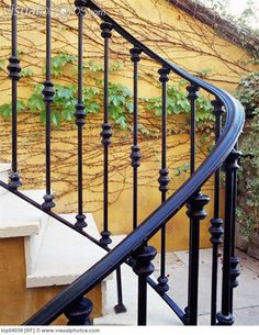 Wraught Iron Railing on an OUtdoor Staircase