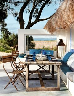 A Perfect Patio Atmosphere Inspired By The Seaside: Blue White Design For Sofa With Rustic Chairs With Wooden Table And Lanterns ~ laurieflo...