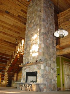 River Rock Fireplace...love stone fireplaces!!