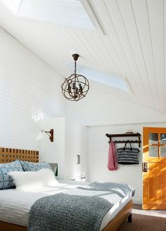 Jasper Mountain Retreat bedroom | Leverone Design | white plank walls orb light