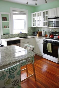 """So pretty! Paint is Benjamin Moore Mantis Green. Also, I'm pretty sure those are the same tiles we used in our old kitchen's backsplash, but b/c of the turquoise walls, of course the turquoise """"came out"""" more than the green. I LOVE the tile (which we bought at The Tile Shop, for the curious)."""