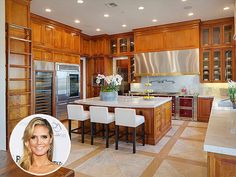 Look Inside These Gorgeous Celebrity Kitchens | HEIDI KLUM | The Project Runway star sold her Brentwood, California Italian-style villa this summer for $24 million, after transforming the eight-acre estate for her and her four children. The stunning kitchen featured state-of-the-art appliances, a warm color scheme and a mixture of stainless steel and natural stone materials.