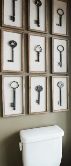 A collection of framed vintage keys decorate the back wall of the powder room…