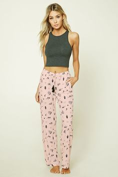 """A pair of lightweight woven PJ pants featuring an allover mixed print of """"Rad"""", pizza, music, and soft drink graphics, an elasticized drawstring waist, and front slant pockets."""