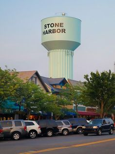 The landmark water tower in the downtown shopping district of Stone Harbor, New Jersey. Sunset tones evoke memories of summer vacation at the shore.