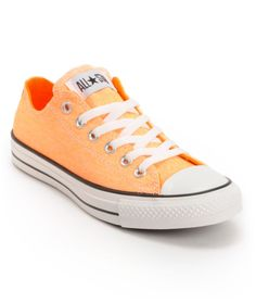 "Converse Chuck Taylor All Star Washed Neon Orange Shoe  Totally buying these as a, ""You worked your ass off to earn enough money to move to Minnesota"" gift for myself. :)"