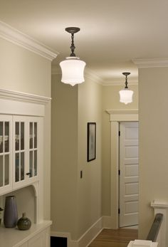 Love the wood trim, built in, and lighting