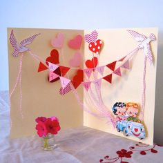 Even if you're not an avid crafter you can easily create a vintage-inspired pop-up Valentine's Day card for that special someone. With a few free printables, decorative paper and festive trimmings, you can transform ordinary cardstock into a delightful holiday card.