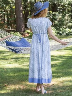 An enticing interpretation of the classic wrap dress- it's even better than the original! The Marielle Hostess showcases a prairie inspired print composed of berries and flowers in gentle shades of blue. The crossover neckline and asymmetrical hem feature soothing solid insets and in our version, the wrap has an attached layered skirt.
