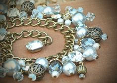 Comprised of vintage rhinestones, Swarovski pearls, Swarovski crystals, and antiqued brass accents, these pieces are full of beautiful elements and eye-catching interest. MEMBER - RewElliott