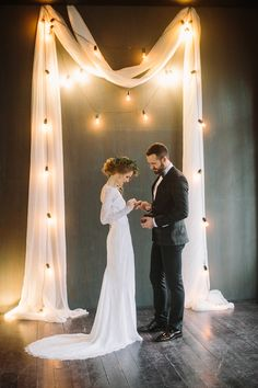 Bistro light wedding ceremony backdrop