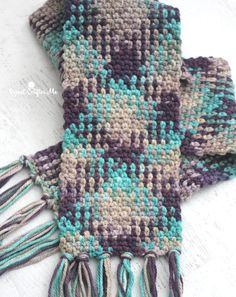 Planned pooling with variegated yarn to achieve argyle results. This method worked wonderfully for me using Loops & Threads Impeccable yarn!