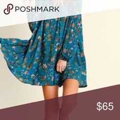 """Floral Print Swing Tunic Sizing: Size S: Bust 35-36"""" Waist 27-28"""" Hips 36-37"""" Size M: Bust 37-38"""" Waist 29-30"""" Hips 38-39"""" Size L: Bust 39-40"""" Waist 31-32"""" Hips 40-41"""" Floral Print Trapeze Swing Dress Fabulous quality swing dress! Love love LOVE this flirty and feminine style!  Fuchsia floral print with front button neck closure. Availability: 2S 2M 2L. Oversized fit. Color is TEAL.  Visit us at our Facebook Shop! https://www.facebook.com/BohoLocoFashionBoutique/ Lace shift Emerald floral…"""