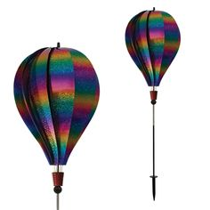 A Hot Air Balloon for your garden! The Patriot Sparkler Hot Air Balloon Ground Spinner comes with a fiberglass pole and ground stake. Next Generation Hot Air Balloons feature a new hub and axle system that allows for smooth revolutions and impressive durability. Balloons ship flat and are easy to assembly with included directions. #sparkle #windspinner #windspinners #gardendecor #yarddecor