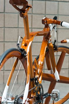 Wooden road bike ~ interesting and lovely finish, more show than actual practically me thinks would this not be rather fragile?