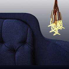 Plumen's Copper Drop Cap Pendants in a cluster against Normann Copenhagen's Onkel Sofa in blue. Copper Lighting, Beautiful Houses Interior, Drop Cap, Backrest Pillow, Inspirational Gifts, Scandinavian Design, Pendants, Sofa, Brown