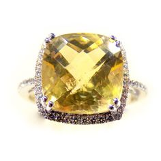 Yellow Topaz ring set in gold and lined with diamonds. So beautiful.