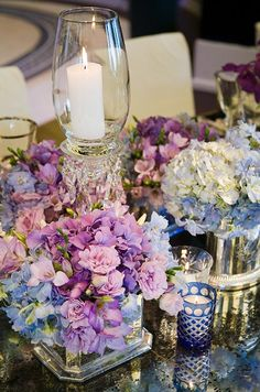 A mix of various blooms in shades of purple, blue and white are mixed for a fresh centerpiece.