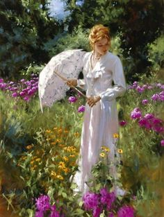 Woman with umbrella in garden
