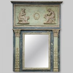 Large French Painted and Gilt Empire Style Trumeau Mirror   Circa 1900 large trumeau mirror has a blue painted finish with some gilded details and features decorative columns and two classical Greek figures in relief.    Item:  #4764     $4895
